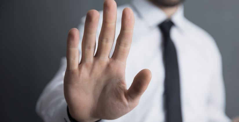 Abwehrende Hand - bildlich für Ausschlussklausel